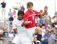 May 12, 2012; Huntsville, AL, USA;  Oak Mountain's David DePriest goes for the ball along with Auburn's Jorge Herrera (4).  Mandatory Credit: Marvin Gentry