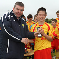 Ronnie Pyne (CSSL Chairman) presents the U13 MOTM Award to Maurice Nugent Avenue United.<br /> Photograph by Flann Howard