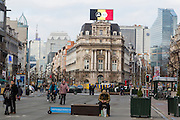 Brussels 23 March 2016. The pedestrian zone at De Brouckere in the center of town, with the Belgian flag on top of a building in LED