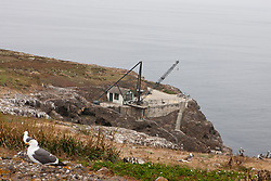 Cranes and loading dock along the cliffs of Anacapa Island, Channel Islands National Park, California, United States of America