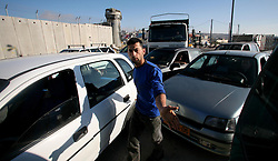 A man gestures as he checks his car after the car behind bumped into it at the Qalandia checkpoint in Ramallah , West Bank, May 6th, 2008. Picture by Andrew Parsons / i-Images