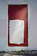 Half-painted red door in Toronto alley behind Dundas Street East near Jarvis Street.