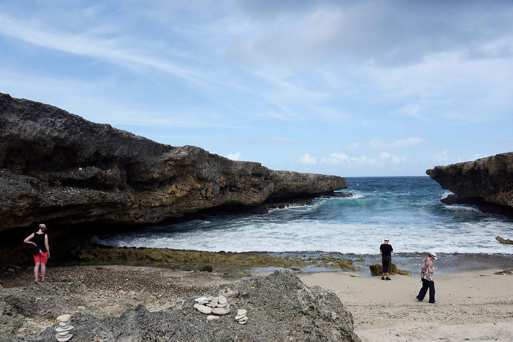WILLEMSTAD, CURACAO - DECEMBER 12, 2014: German tourists explore the caves at Shete Boka National Park in Curacao's Westpunt region. (photo by Melissa Lyttle)