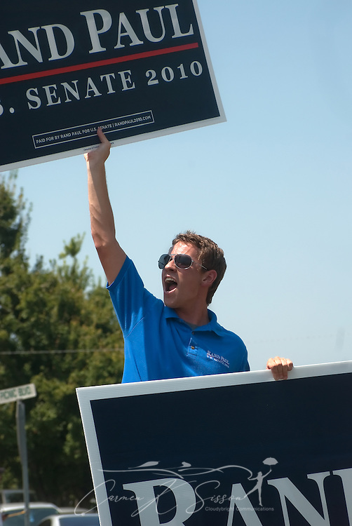 Lance Wheeler chants as he holds up signs supporting Republican Senate candidate Rand Paul Aug. 7, 2010 at the 130th annual Fancy Farm picnic and political rally in Fancy Farm, Ky. Wheeler, who attends the University of Kentucky, is state youth coordinator for Paul's campaign. (Photo by Carmen K. Sisson/Cloudybright)