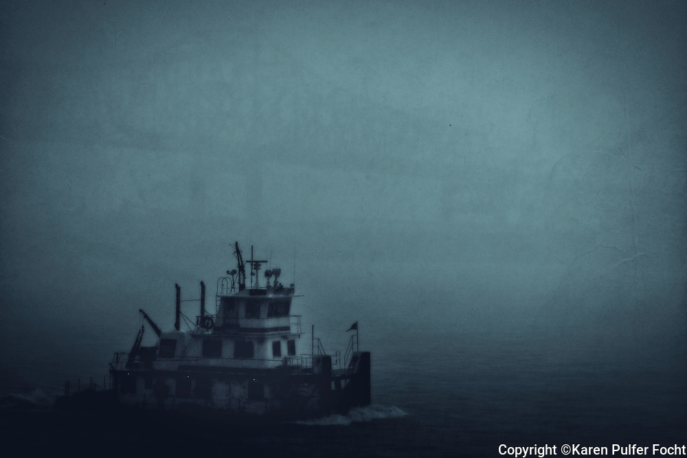 A tug boat chugs along the Lower Mississippi River through a torrential downpour near Baton Rouge, Louisiana.