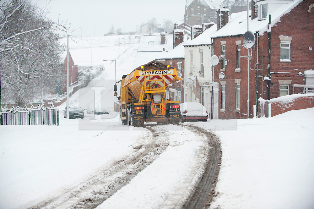 © Licensed to London News Pictures. 23/03/2013. Pitsmoor Sheffield. Gritters on the streets of Sheffield after another night of snow. Photo credit : David Mirzoeff/LNP