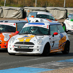 KNOCKHILL Scottish Motor Racing Club meetingl...Malcolm McNab (4) takes the inside line on the exit from the hairpin....(c) STEPHEN LAWSON | StockPix.eu