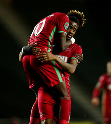 Swansea City's Jordan Ayew (right) celebrates with Tammy Abraham after scoring their fourth goal during the Carabao Cup, Second Round match at Stadium MK, Milton Keynes.