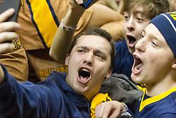 West Virginia fans react after beating Kansas at the WVU Coliseum.