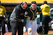 Oakland Athletics left fielder Matt Joyce (23) reacts to hitting a foul ball off his leg during an exhibition game against the San Francisco Giants at Oakland Coliseum in Oakland, California, on March 25, 2018. (Stan Olszewski/Special to S.F. Examiner)