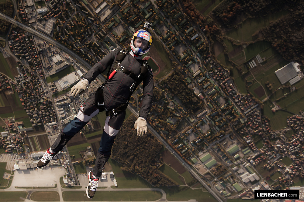 Marco Waltenspiel of the Red Bull Skydive Team is backflying over Salzburg