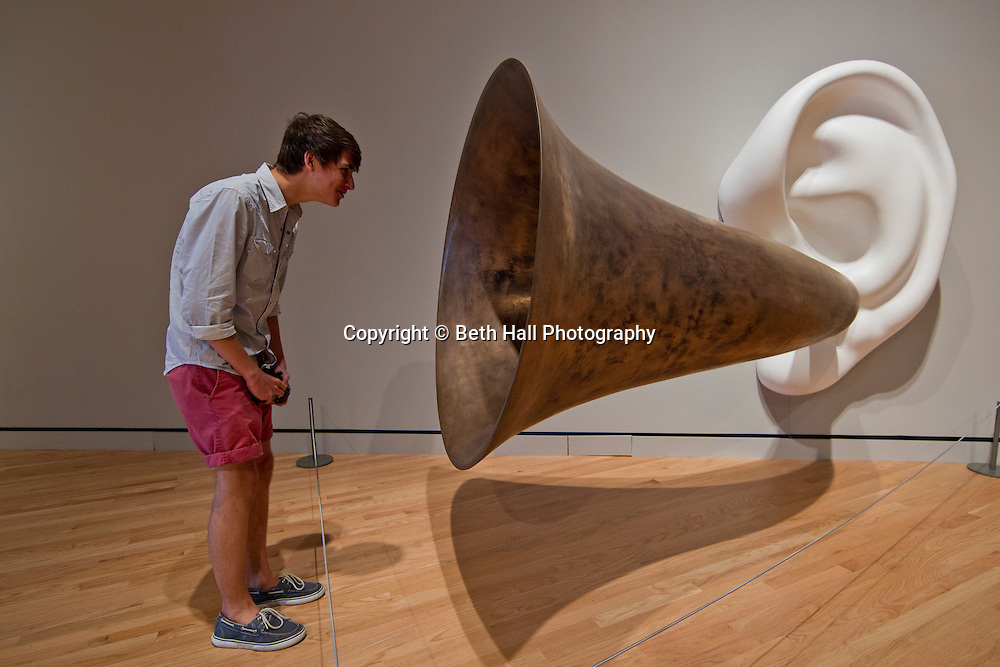 Samuel Snodgrass of Springfield, Mo., speaks into a George Rickey sculpture, One Fixed Four Jointed Lines Bised, in the center of the main entrance at Crystal Bridges Museum of American Art on Monday, June 10, 2013,  in Bentonville, Ark.
