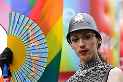 © Licensed to London News Pictures. 06/07/2019. London, UK. A participant wearing a policeman hat at the annual Pride Parade in central London. An estimated over 1 million people lined along the route in support of the LGBT (Lesbian, Gay, Bisexual and Transgender/Transsexual) community. Photo credit: Dinendra Haria/LNP
