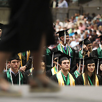 Members of the Mooreville High School graduating class of 2019 watch as their classmates walk across the stage to receive their diplomas at the BancorpSouth Arena on Saturday.