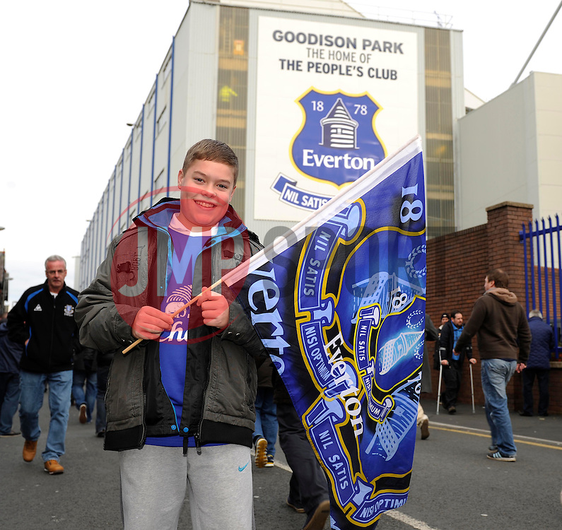 An Everton FC fan outside Goodison Park - Photo mandatory by-line: Dougie Allward/JMP - Tel: Mobile: 07966 386802 23/11/2013 - SPORT - Football - Liverpool - Merseyside derby - Goodison Park - Everton v Liverpool - Barclays Premier League