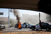 Traffic arrest and burning car at the end of a police chase in American Canyon, Napa County, CA.