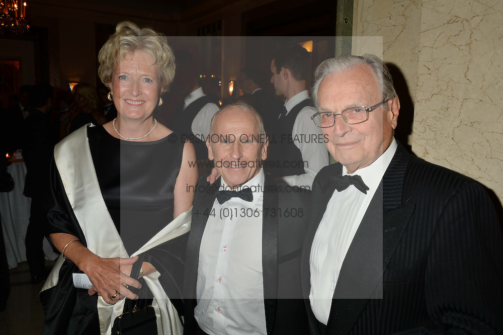 Left to right, LADY CHADLINGTON, WAYNE SLEEP and SIR PETER WRIGHT at a dinner hosted by the Royal Academy of Dance to present the Queen Elizabeth II Award 2014 held at Claridge's, Brook Street, London on 4th September 2014.