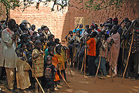 BURKINA FASO, Bani, 2007. By midday, almost everyone in this group was clearly exhausted, yet the singer's call and response continued until well after dark.