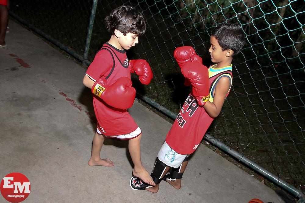 August 25, 2011; Rio De Janiero, Brazil; Brendan Schaub donates training gear to children in a Muy Thai school in a Favela.