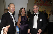 Mr. and Mrs. Howard Lee and Michael  Howard. The Leader's Dinner ( Michael Howard's ) Banqueting House. Whitehall. London.  November 2005. ONE TIME USE ONLY - DO NOT ARCHIVE  © Copyright Photograph by Dafydd Jones 66 Stockwell Park Rd. London SW9 0DA Tel 020 7733 0108 www.dafjones.com