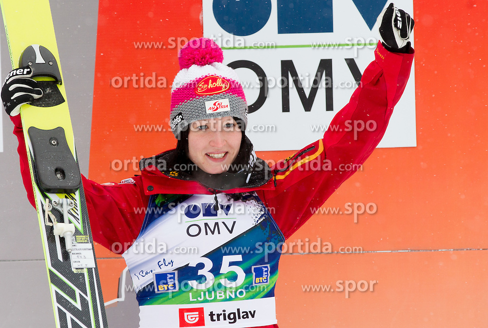 Third placed Jacqueline Seifriedsberger of Austria celebrates during trophy ceremony after the Normal Hill Individual Competition at FIS World Cup Ski jumping Ladies Ljubno 2012, on February 12, 2012 in Ljubno ob Savinji, Slovenia. (Photo By Vid Ponikvar / Sportida.com)