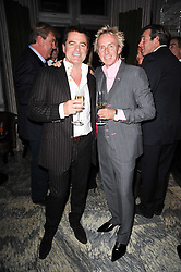 Left to right, CHARLES WORTHINGTON and ALLAN PETERS at a dinner hosted by Ruinart in honour of Amanda Wakely at The Connaught, Carlos Place, London on 20th October 2010.