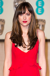 © Licensed to London News Pictures. 14/02/2016. London, UK. DAKOTA JOHNSON arrives on the red carpet for the EE British Academy Film Awards 2016 after party held at Grosvenor House . London, UK. Photo credit: Ray Tang/LNPPhoto credit: Ray Tang/LNP