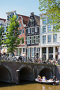 Bridge and canalside gabled houses - Dutch gables - corner Herenstraat and Herengracht, Jordaan District of Amsterdam