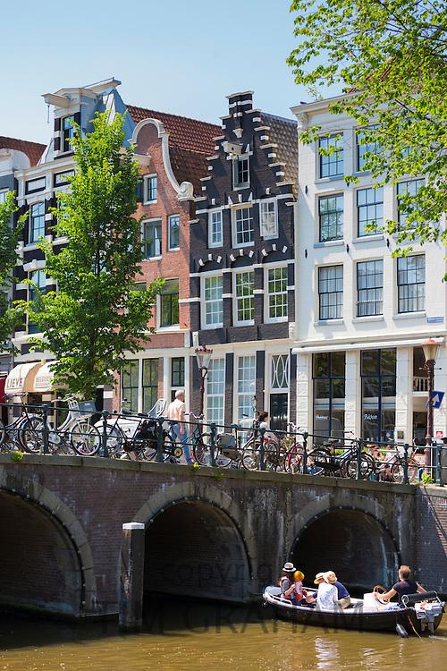 Bridge and canalside gabled houses - Dutch gables - corner Herenstraat and Herengracht, Jordaan District of Amsterdam