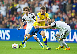 SWANSEA, WALES - Saturday, September 28, 2013: Arsenal's Oliver Giroud in action against Swansea City during the Premiership match at the Liberty Stadium. (Pic by David Rawcliffe/Propaganda)