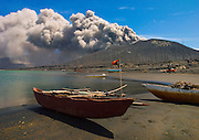 "Living under the volcano in Papua<br /> <br /> September 19, 1994 - An eruption of volcanoes on the opposite side of the harbor entrance devastated the town<br /> of Rabaul, the former capital of East New Britain Island in Papua New Guinea.<br /> Thanks to an early warning, very few people died. Rabaul's town and harbor are craters made after massive explosions of gas, ash, rocks and lava took place about 1400 years ago.<br /> In 1994, the town had to be evacuated because volcanoes Tavurvur, Vulcan and<br /> Rabalankaia erupted. Over 30,000 people left the town itself and a further 50,000 from the surrounding area. Only four people lost their lives from the ash falls. One other was killed by a lightning strike south of Vulcan. This is a remarkably low death toll bearing in mind the potential for a much higher number had an evacuation not taken place in time.<br /> When the volcanoes erupted in 1937, 500 people died.<br /> The rains have soaked up the thick ash that has fallen on houses, and the weight  has collapsed an estimated 80% of the buildings.<br /> There is one hotel under the volcano The ""Rabaul hotel"" still welcomes tourists. After being severely damaged by fire in 1984 the hotel was rebuilt and reopened in 2005.<br /> All the rooms have a volcano view though you can't see much since the wind blows the ashes towards the hotel. It is an incredible experience. Once in the nice clean room, you feel like you're in a submarine!<br /> Living in and around Rabaul is safe as the volcanoes are quite predictable and<br /> are constantly monitored for the precursors of activity.<br /> The former airport is now under 3 meters of ash. Rabaul Airport was completely destroyed in the 1994 eruption.<br /> The airport was in the direct path of the falling ash. Nobody knows why they built it at the foot of the volcano, since there has been a history of eruptions.<br /> Some people still live in the volcano area as they do not have enough money to leave their homes. All day long, they have to protect themselves from ashes and winds. My camera did not res"