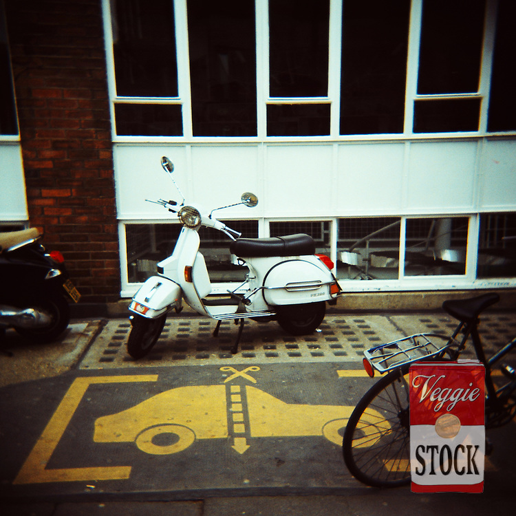 A Vespa scooter in the streets near Brick Lane, London, May 2008.