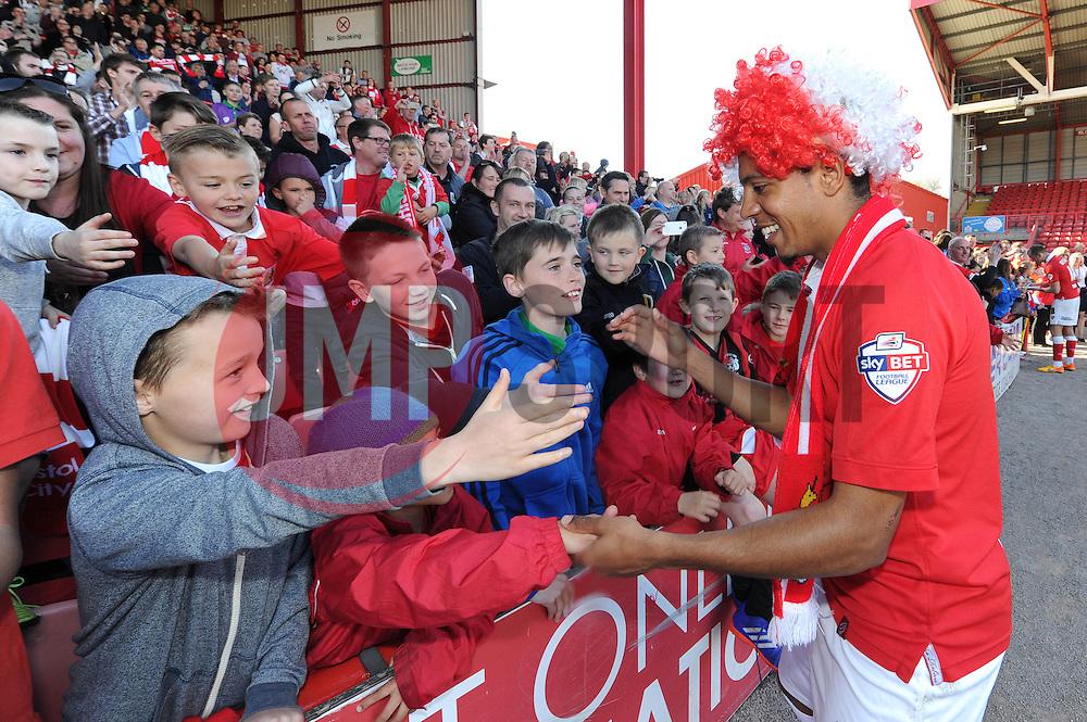 Bristol City's Korey Smith shakes hands with fans as Bristol City win the league - Photo mandatory by-line: Dougie Allward/JMP - Mobile: 07966 386802 - 18/04/2015 - SPORT - Football - Bristol - Ashton Gate - Bristol City v Coventry City - Sky Bet League One