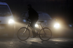 © Licensed to London News Pictures. 15/11/2012.A cyclist in the borough of Bromley, Kent, South East London border traveling to work in the fog this morning as temperatures drop in the South East..Photo credit : Grant Falvey/LNP