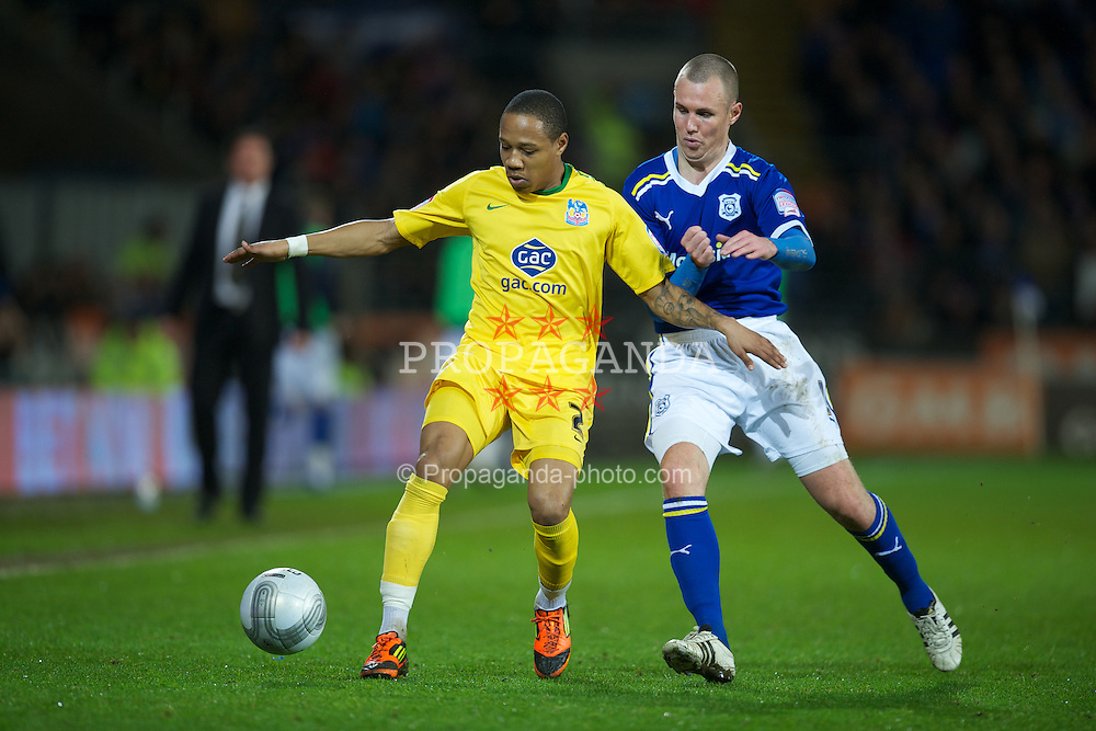 CARDIFF, WALES - Tuesday, January 24, 2012: Cardiff City's Kenny Miller in action against Crystal Palace's Nathaniel Clyne during the Football League Cup Semi-Final 2nd Leg at the Cardiff City Stadium. (Pic by David Rawcliffe/Propaganda)