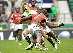 Mark Richards of South Africa is caught by Horace Otieno of Kenya during the Plate final match between South Africa and Kenya at the Marriott London Sevens rugby tournament being held at Twickenham Rugby Stadium in London as part of the HSBC Sevens World Series,  Sunday, 11th May 2014. Picture by Roger Sedres / i-Images