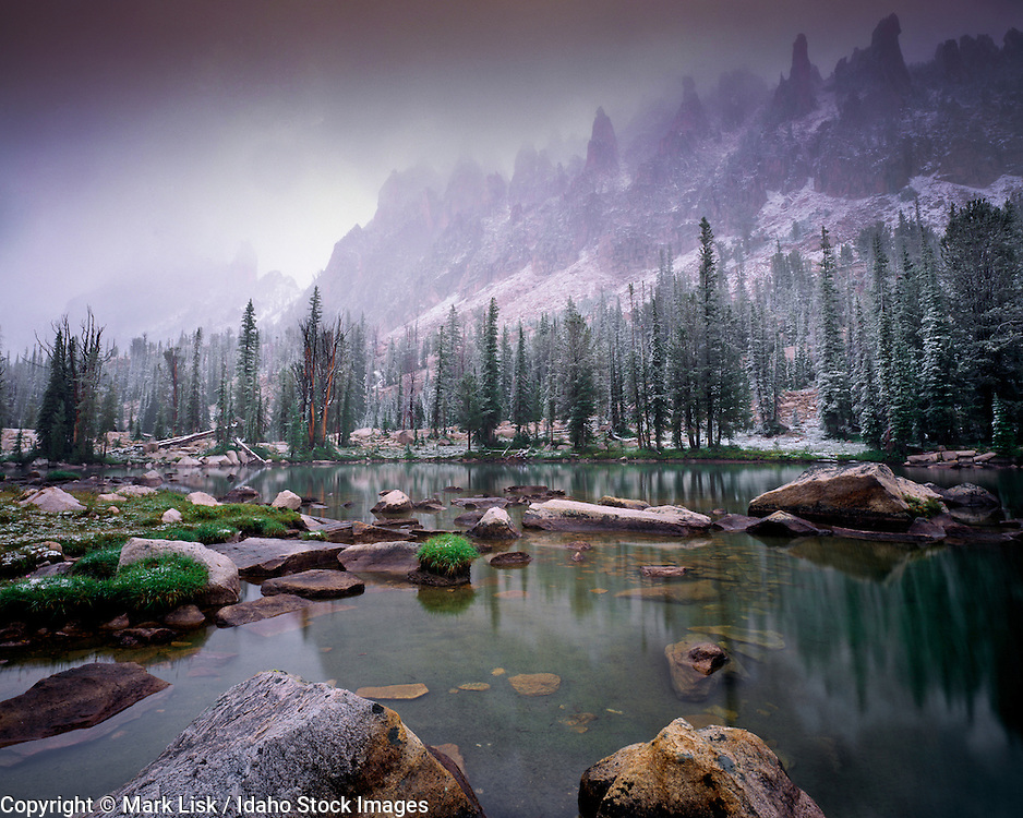 Mist rises to unveil a dusting of snow on the mountains. Feather Lakes, Sawtooth Wilderness Area, Id.