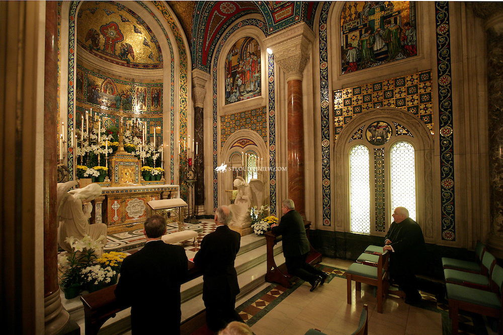 TUESDAY, APRIL 21, 2009 - Archbishop-elect Robert J. Carlson (top) prayed in a chapelmade his first visit to his new archdiocese Tuesday visiting several locations through the area...©Photo by Jerry Naunheim Jr.... ..