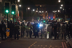 licensed to London News Pictures. London, UK. 7th August 2011. Rioting in Tottenham, London. Police line on Tottenham High Road. Violence and looting breaks out from Tottenham High Road after the police shooting of 29-year-old Mark Duggan. Please see special instructions for usage rates. Photo credit should read Jules Mattsson/LNP