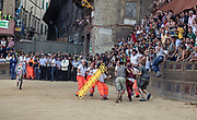 """Italy, Siena, the Palio: horses get rid of their Jockeys at the Curva del CasatoOn the basis of a detailed reconstruction of horse accidents which have happened on this race-track during the last 20 years of the Palio, we see that the greatest number of accidents have happened at San Martino (57% of the cases) in respect to """"Casato"""" (37% of the cases.)<br /> <br /> But while at the curve at San Martino the accidents have happened both on the first lap (45%) as well as on the second lap (55%), at the """"Casato"""" curve the accidents have happened mostly on the first lap (70%). At the shot of the mortaretto, the horses come out of the Entrone and line up at the starting line, known as the mossa. As soon as the last horse reaches the starting line the race begins and lasts for three rounds of the square (about 1 kilometre in total). The first horse to cross the finishing line is the winner, regardless of whether it is still mounted."""