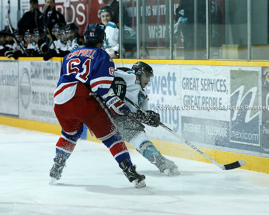 Lindsay, ON - Jan 31 : Ontario Junior Hockey League game action between the Lindsay Muskies and the North York Rangers. Tye Campbell #61 of the North York Rangers Hockey Club and a Lindsay player battles for the puck during second period game action.<br /> (Photo by Tim Bates / OJHL Images)