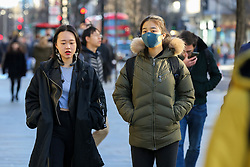 © Licensed to London News Pictures. 29/01/2020. London, UK. A woman is seen on Oxford Street, in West End wearing a fashionable face mask following the outbreak of Coronavirus in Wuhan,  which has killed 132 people and infected more than 6,000. According to the Department of Heath, 97 people have been tested for Coronavirus in the UK and all have been confirmed negative. Photo credit: Dinendra Haria/LNP