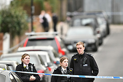 © Licensed to London News Pictures. 17/10/2017. London, UK. Police at the scene in West Hampstead where a 17 and 18 year old were arrested in connection with a stabbing at Fleming Court in Little Venice, near Paddington in which a 28-year-old man has died. Police believe the suspects are two males who were riding a moped. Photo credit: Ben Cawthra/LNP