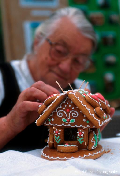 CZECH REPUBLIC PRAGUE JUL00 - Jirina Dvorakova (68) decorates plates of gingerbread which fit together as a gingerbread house. Mrs Dvorakova is a representative of folkloristic craftsmen who promotes her small trade.. . jre/Photo by Jiri Rezac. . © Jiri Rezac 2000. . Tel:   +44 (0) 7050 110 417. Email: jiri@jirirezac.com. Web:   www.jirirezac.com