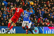 Alfredo Morelos of Rangers is challenged by Scott McKenna of Aberdeen FC during the William Hill Scottish Cup quarter final replay match between Rangers and Aberdeen at Ibrox, Glasgow, Scotland on 12 March 2019.