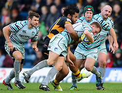 Leicester Scrum-Half (#9) Sam Harrison is tackled by Wasps Number 8 (#8) Billy Vunipola during the first half of the match - Photo mandatory by-line: Rogan Thomson/JMP - Tel: Mobile: 07966 386802 25/11/2012 - SPORT - RUGBY - Adams Park - High Wycombe. London Wasps v Leicester Tigers - Aviva Premiership.