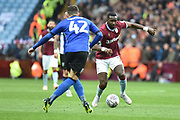Aston Villa midfielder (on loan from Everton) Yannick Bolasie (11) takes on Sheffield Wednesday defender Matt Penney (42) during the EFL Sky Bet Championship match between Aston Villa and Sheffield Wednesday at Villa Park, Birmingham, England on 22 September 2018.