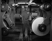 The Times press operator Gerald Williams poses for a portrait with a press Thursday at The Times Media Co. in Munster.