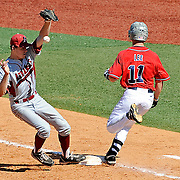 Mississippi's Braxton Lee (11) reaches first base on a bunt past Arkansas second baseman Brian Anderson (1) during an NCAA college baseball game in Oxford, Miss., Saturday, May 3, 2014. (Photo/Thomas Graning)