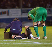 Dundee's Jake Hyde gets treatment from physio Karen Gibson while Greenock Morton goalkeeper Dominic Cervi checks that Hyde is OK - Greenock Morton v Dundee - IRN BRU Scottish Football League First Division at Cappielow. .- © David Young -.5 Foundry Place - .Monifieth - .Angus - .DD5 4BB - .Tel: 07765 252616 - .email: davidyoungphoto@gmail.com - .http://www.davidyoungphoto.co.uk